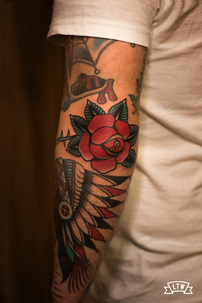 Traditional rose tattooed on the elbow by Dennis