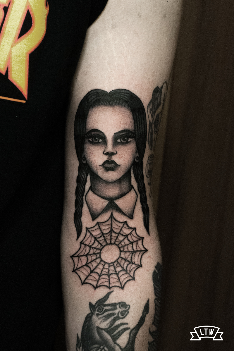 Wednesday from The Addams Family tattoo done by Dennis