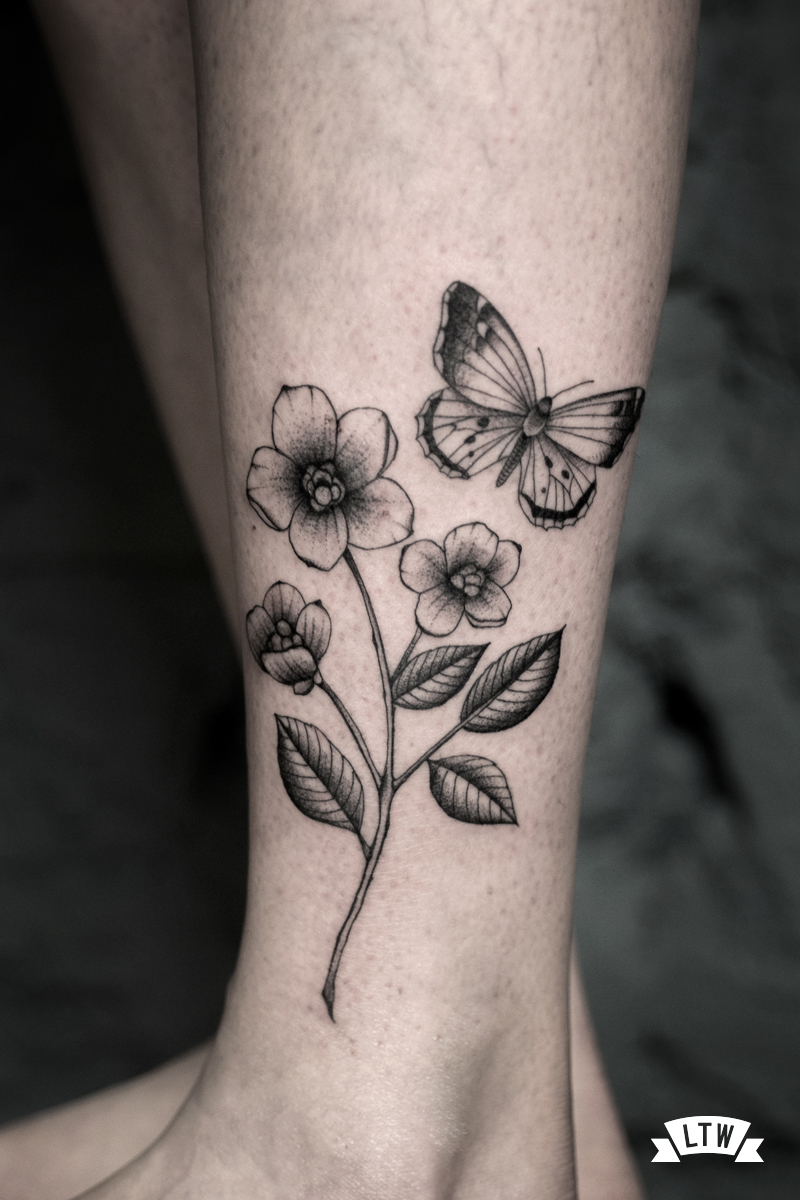 Black and grey tattoo with flowers and butterfly by Dani Cobra