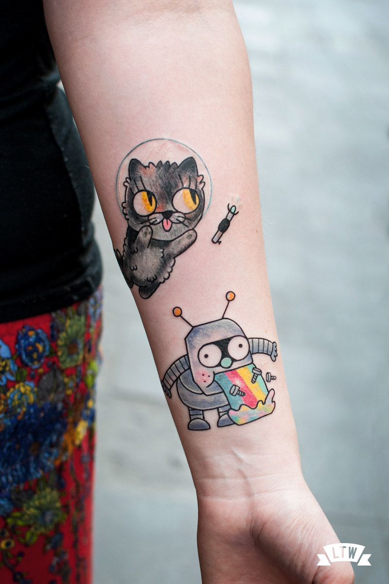 Space cat tattooed by Numi
