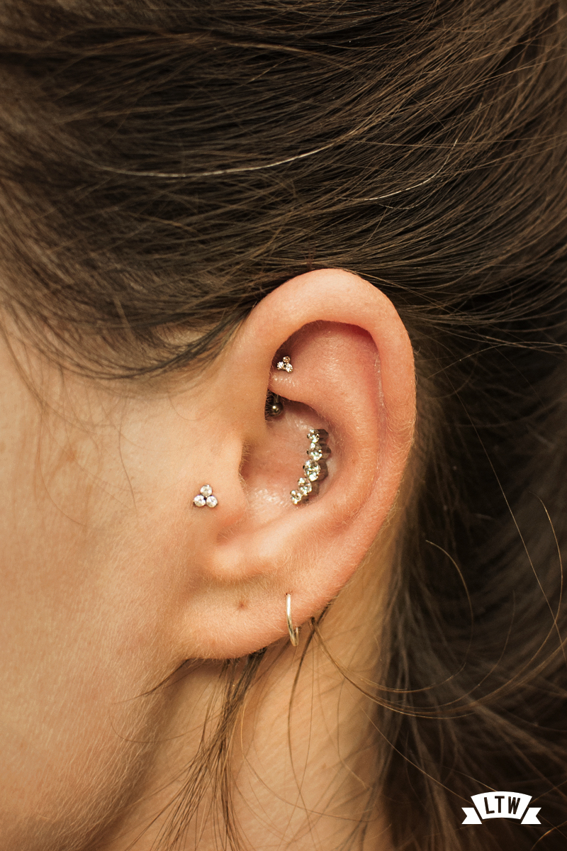 Rook, conch and tragus done by Sergi Tinaut with jewelry from Industrial Strenght