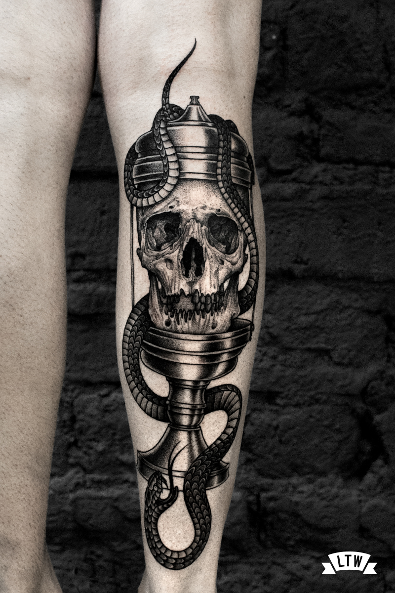 Skull tattooed in black and grey by Andreu Matallana