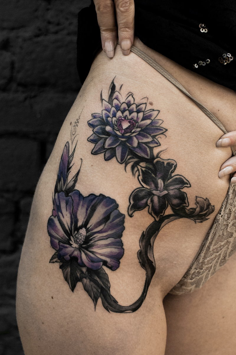 Flowers tattooed by Man