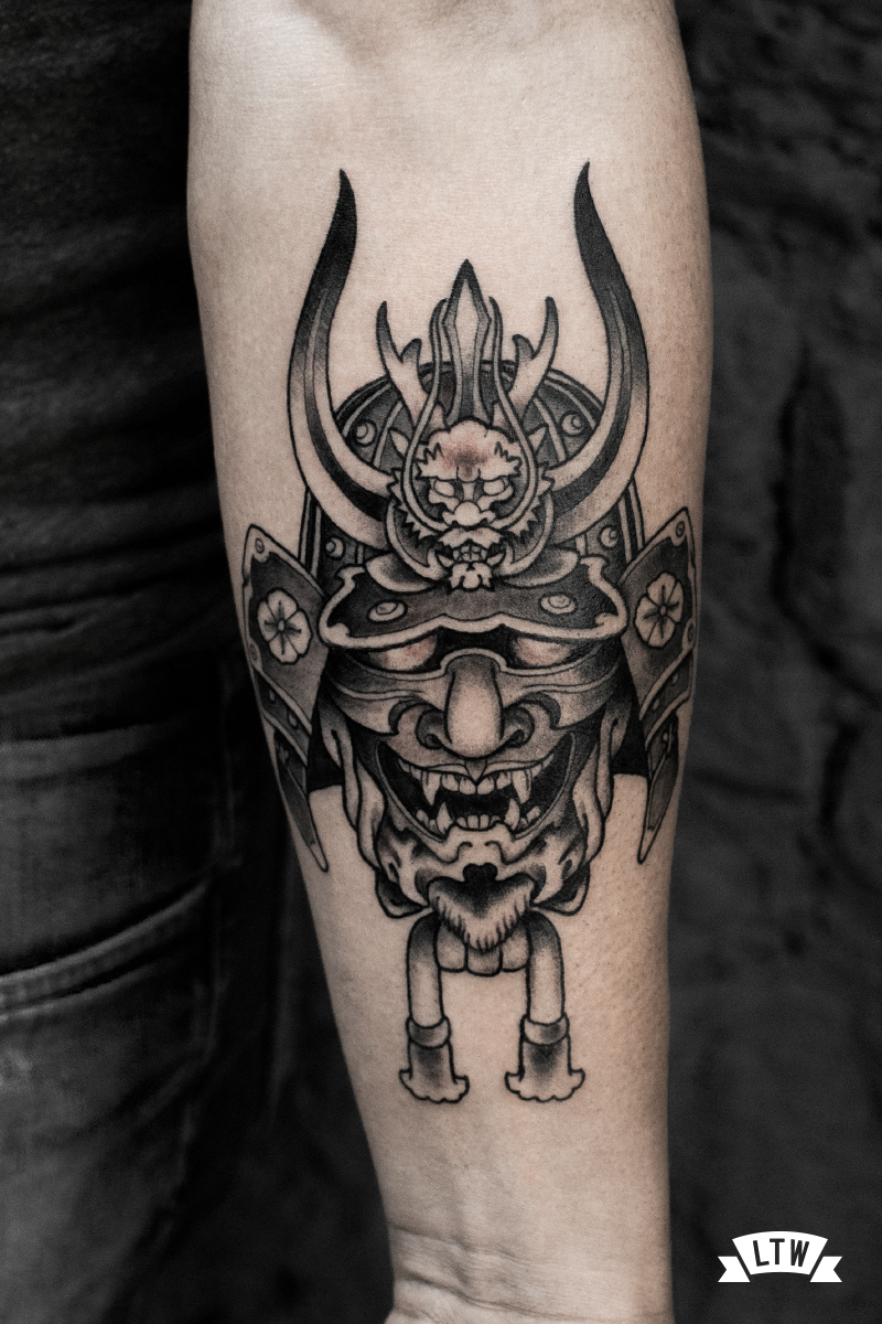 Mask tattooed by Rafa Serrano in black and grey