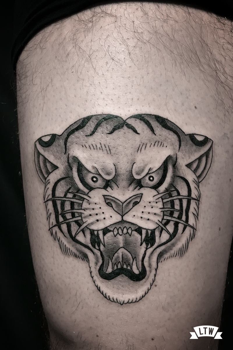 Tiger head tattooed by Alexis in black and grey