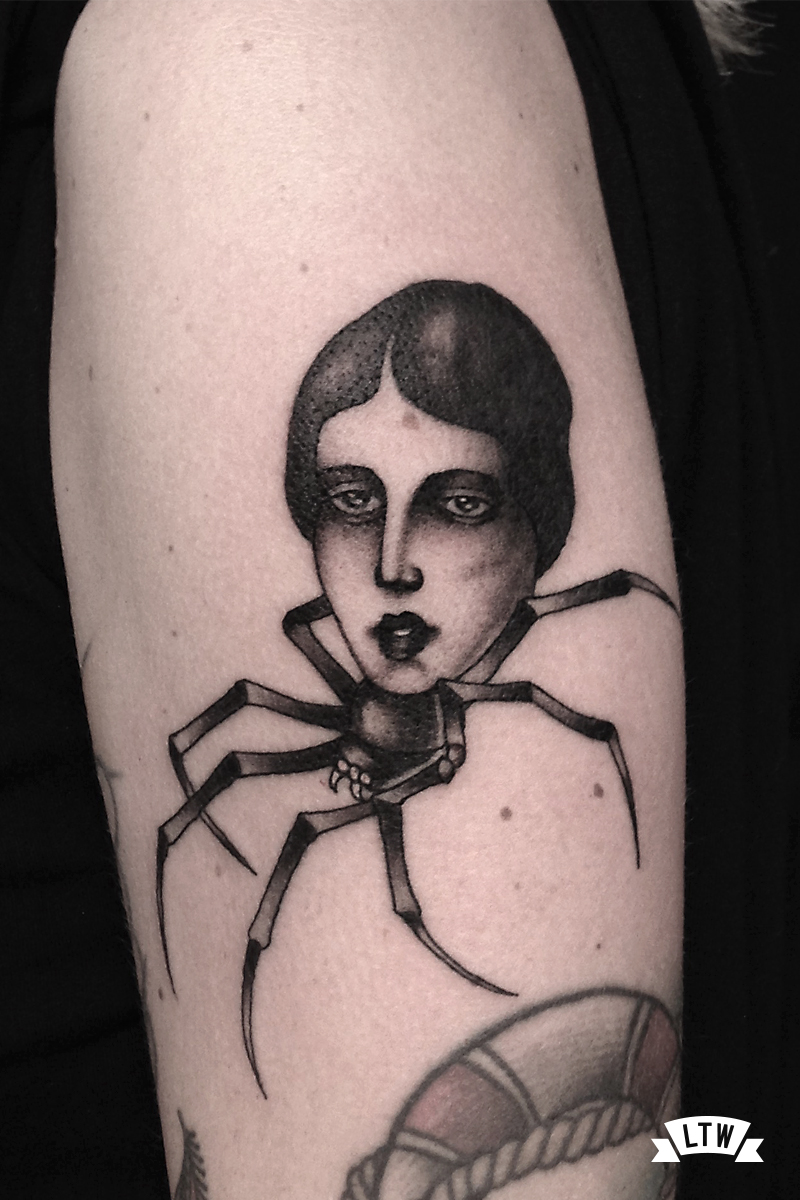 Spider woman tattooed by Alexis