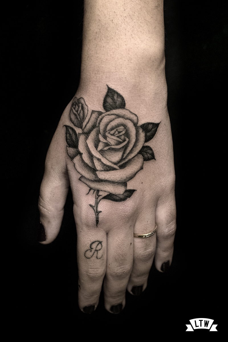Rose tattooed on a hand by Alexis