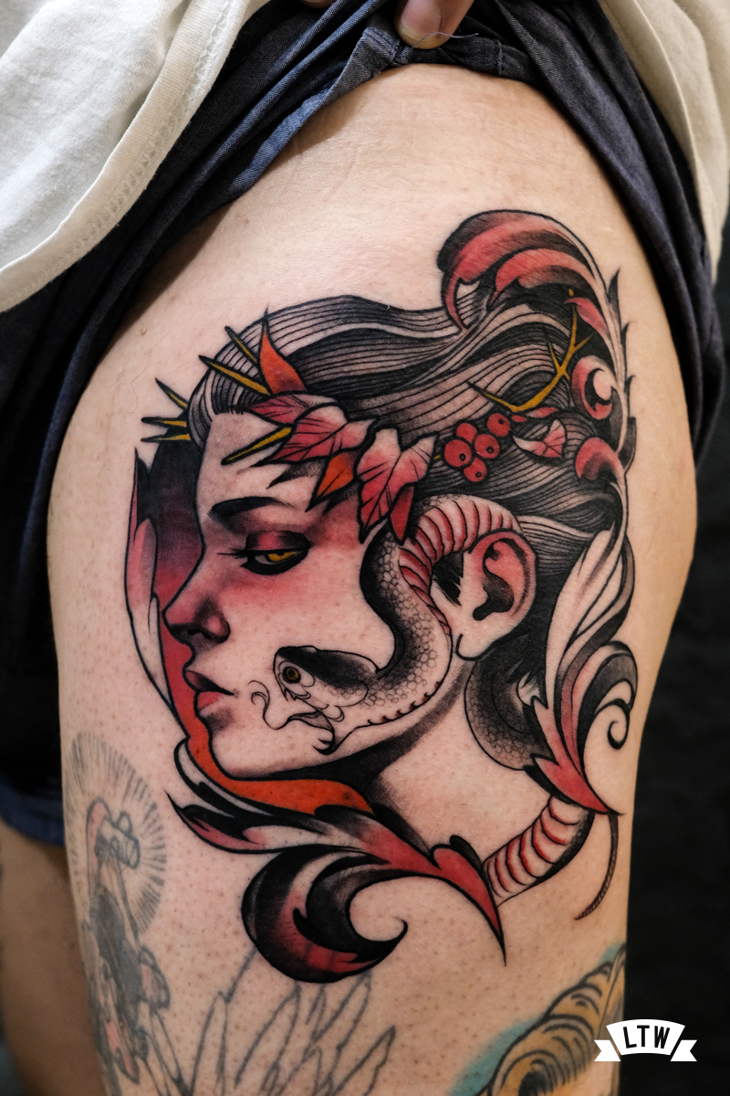 Woman and snake tattooed by Man
