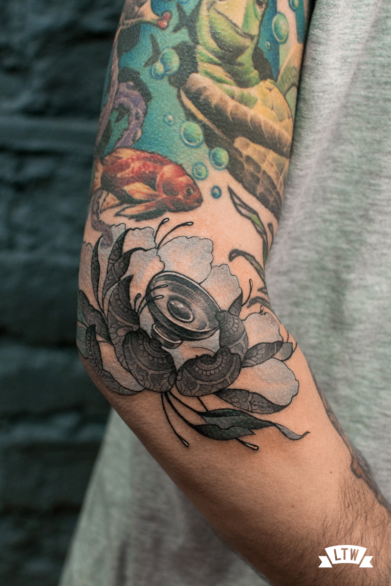 Flower tattooed by Jon Pall
