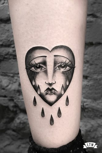 Black and white heart tattooed by Enol