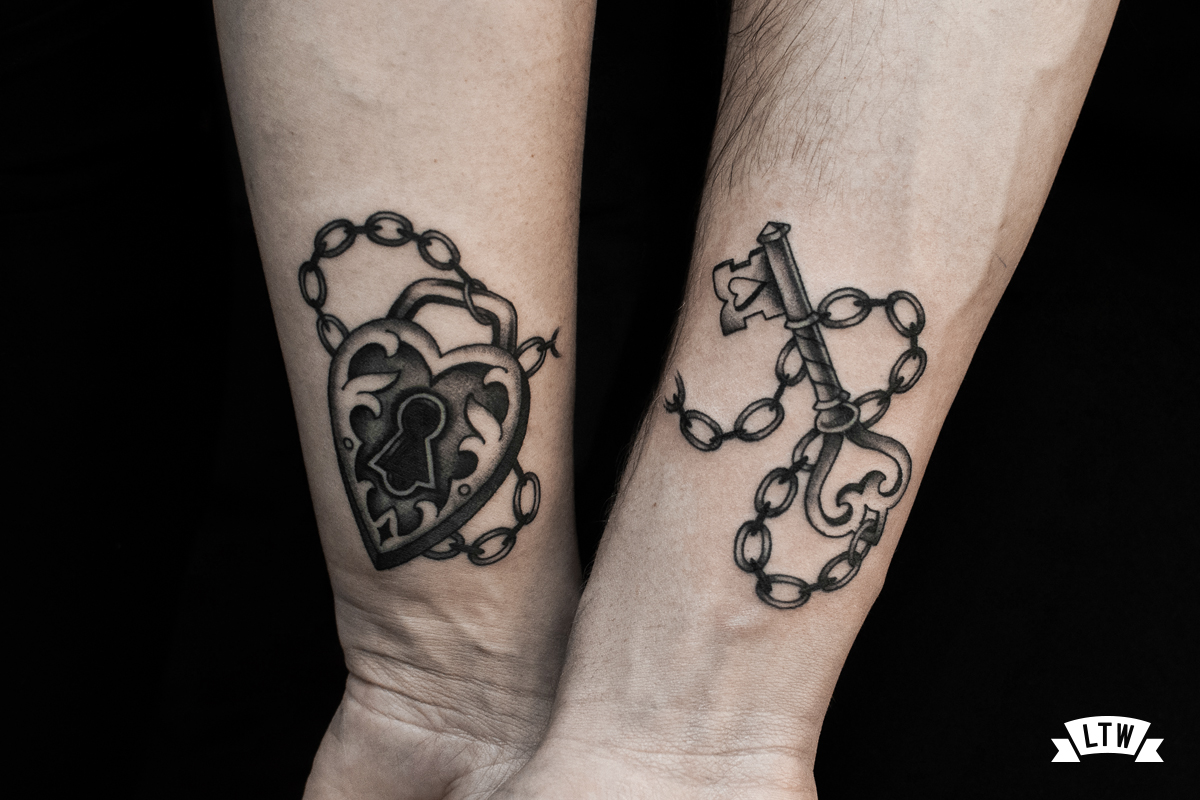 Key and padlock tattooed by Enol