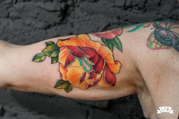 Flower tattooed in color by Jon Pall