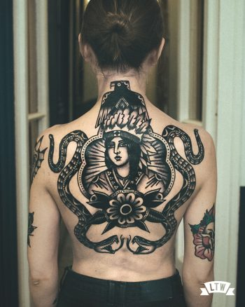 Back piece tattooed in black and white by Dennis