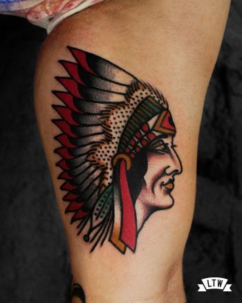 Native american tattooed on a biceps by Dennis