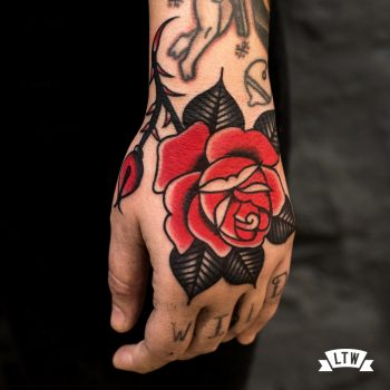 Rose tattooed on a hand by Dennis