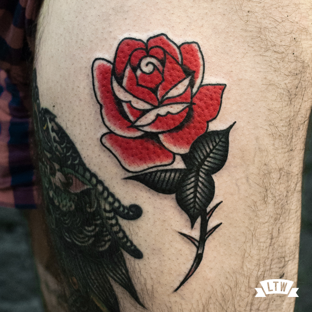 Red rose tattooed by Dennis